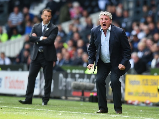 Steve Bruce barks as Darren Wassall watches on during the Championship playoff semi-final between Derby County and Hull City on May 14, 2016