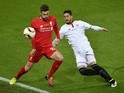 Adam Lallana and Sergio Escudero in action during the Europa League final between Liverpool and Sevilla on May 18, 2016