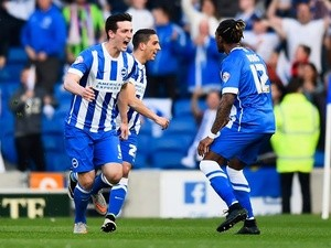 Lewis Dunk of Brighton & Hove Albion celebrates with Gaetan Bong as he scores their first goal during the Championship playoff semi-final second leg against Sheffield Wednesday on May 16, 2016
