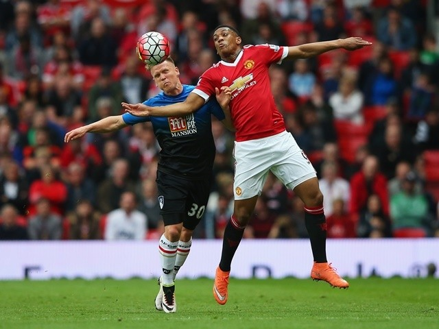 Anthony Martial of Manchester United and Matt Ritchie of Bournemouth battle for the ball at Old Trafford on May 17, 2016