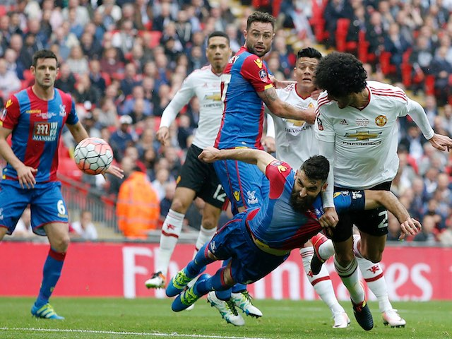 Marouane Fellaini beats Mile Jedinak to the ball during the FA Cup final between Crystal Palace and Manchester United on May 21, 2016