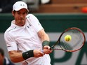 Andy Murray goes for a backhand during his French Open fourth round meeting with John Isner at Roland Garros on May 29, 2016