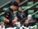 Kei Nishikori celebrates after winning against Simone Bolelli at the French Open in Paris on May 23, 2016