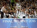 Real Madrid players celebrate with the trophy after the Champions League final between Real Madrid and Atletico Madrid on May 28, 2016