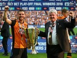 Alex Bruce and Steve Bruce celebrate after the Championship playoff final between Hull City and Sheffield Wednesday on May 28, 2016