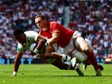 England winger Anthony Watson touches down despite the best efforts of Wales counterpart George North during the meeting between the two sides at Twickenham on May 29, 2016