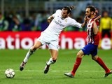 Gareth Bale holds off Juanfran during the Champions League final between Real Madrid and Atletico Madrid on May 28, 2016
