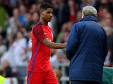 Marcus Rashford is congratulated by England manager Roy Hodgson following his goalscoring debut for the Three Lions against Australia on May 27, 2016