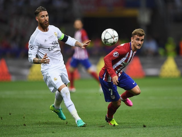 Antoine Griezmann and Sergio Ramos in action during the Champions League final between Real Madrid and Atletico Madrid on May 28, 2016