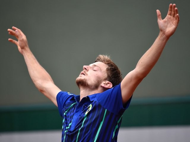 David Goffin celebrates winning his third-round match at the French Open on May 28, 2016
