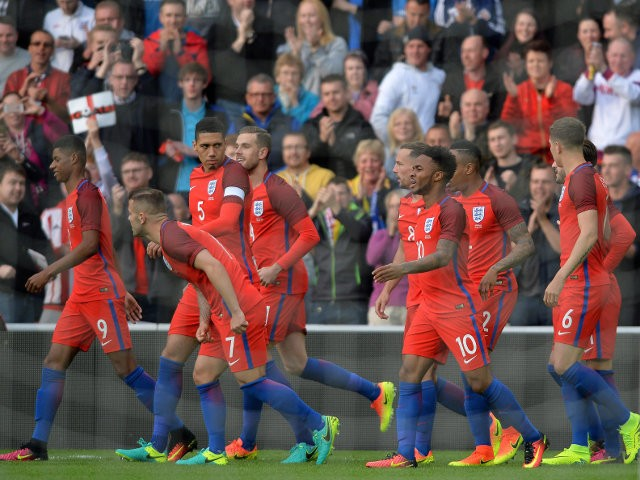 England players congratulate Marcus Rashford's debut goal during the 2-1 win over Australia at the Stadium of Light on May 27, 2016