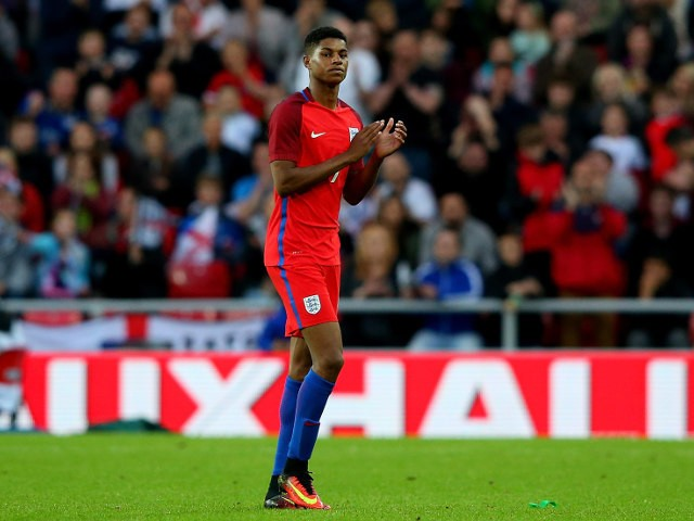 England striker Marcus Rashford walks off the field after scoring on his debut during the 2-1 win over Australia at the Stadium of Light on May 27, 2016