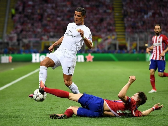 Saul Niguez and Cristiano Ronaldo in action during the Champions League final between Real Madrid and Atletico Madrid on May 28, 2016