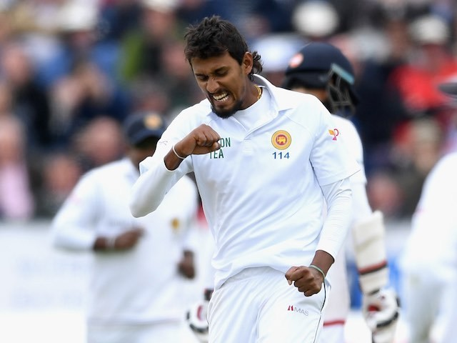 Suranga Lakmal celebrates dismissing Chris Woakes during day two of the second Test between England and Sri Lanka on May 28, 2016