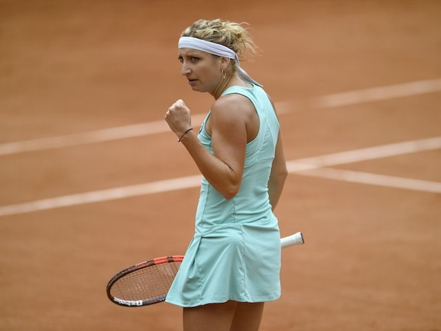 Timea Bacsinszky celebrates winning a point during the second round of the French Open on May 26, 2016