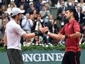 Andy Murray congratulates Novak Djokovic on winning the men's final match at the French Open on June 5, 2016