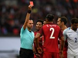 Portugal defender Bruno Alves is shown a red card for a challenge on Harry Kane during his side's match against England at Wembley on June 2, 2016