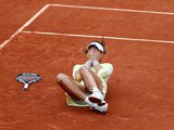 Garbine Muguruza falls to the ground after winning the French Open on June 4, 2016