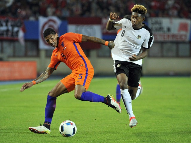 Austria's David Alaba (R) and Patrick van Aanholt of the Netherlands vie during the EURO 2016 friendly football match Austria vs Netherlands at Ernst Happel stadium in Vienna, Austria, on June 4, 2016