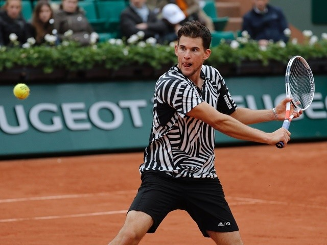 Dominic Thiem returns the ball to David Goffin during the quarter-finals of the French Open on June 2, 2016