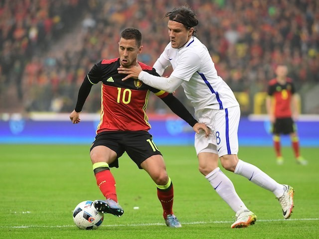 Eden Hazard is strangled by Perparim Hetemaj during the international friendly between Belgium and Finland on June 1, 2016