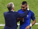 France's forward Dimitri Payet (R) is congratulated by France's coach Didier Deschamps after scoring the 2-1 goal during the Euro 2016 group A football match between France and Romania at Stade de France, in Saint-Denis, north of Paris, on June 10, 2016
