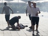 An England fan is unconscious on the ground after clashes ahead of the game against Russia on June 11, 2016
