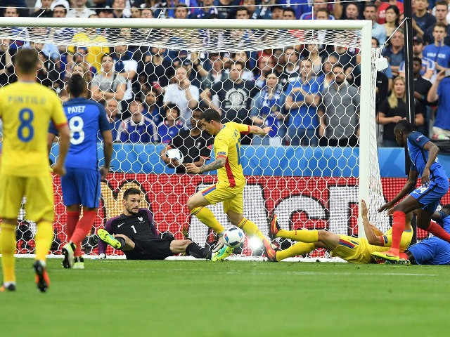 France's goalkeeper Hugo Lloris (C) and Romania's forward Bogdan Stancu (C-R) vie for the ball during the Euro 2016 group A football match between France and Romania at Stade de France, in Saint-Denis, north of Paris, on June 10, 2016