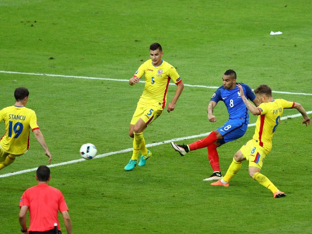 imitri Payet of France scores his team's second goal during the UEFA Euro 2016 Group A match between France and Romania at Stade de France on June 10, 2016 in Paris, France