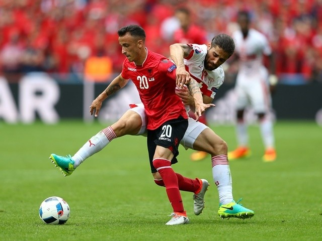 Ergys Kace of Albania and Ricardo Rodriguez of Switzerland compete for the ball in their Euro 2016 Group A match on June 11, 2016