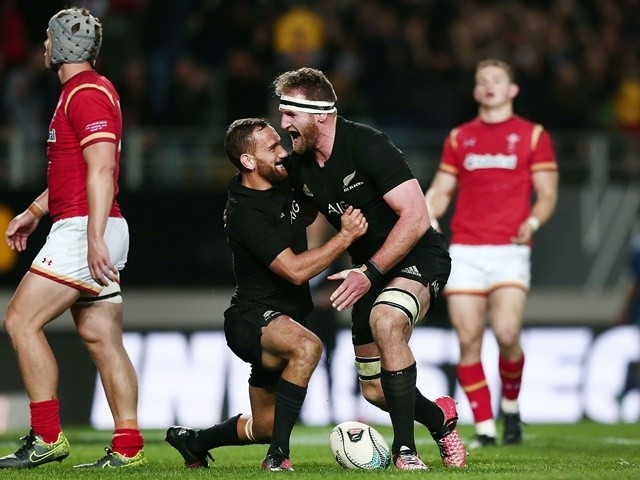 Kieran Read of New Zealand celebrates after scoring a try with teammate Aaron Cruden during the international Test against Wales on June 11, 2016