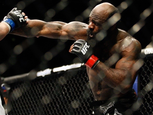 Kimbo Slice punches Matt Mitrione in their heavyweight bout at UFC 113 at Bell Centre on May 8, 2010