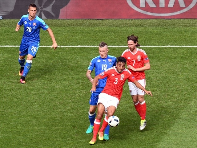 Slovakia's Juraj Kucka and Wales's Neil Taylor and Joe Allen in action at Euro 2016 on June 11, 2016