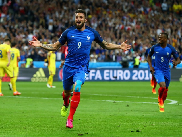 Olivier Giroud of France celebrates scoring his team's first goal during the UEFA Euro 2016 Group A match between France and Romania at Stade de France on June 10, 2016 in Paris, France