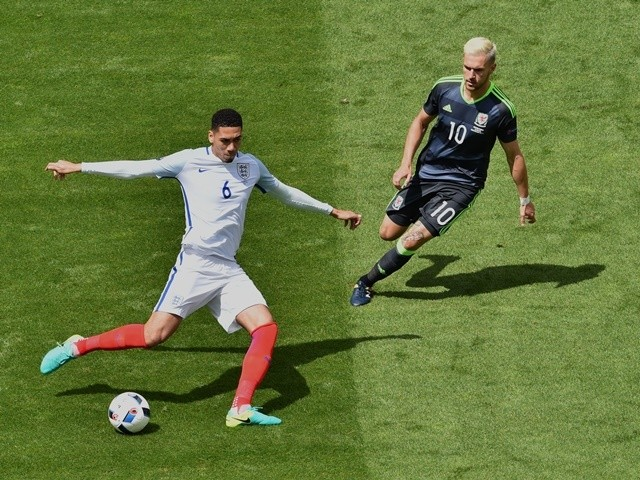 Aaron Ramsey and Chris Smalling in action during the Euro 2016 Group B game between England and Wales on June 16, 2016