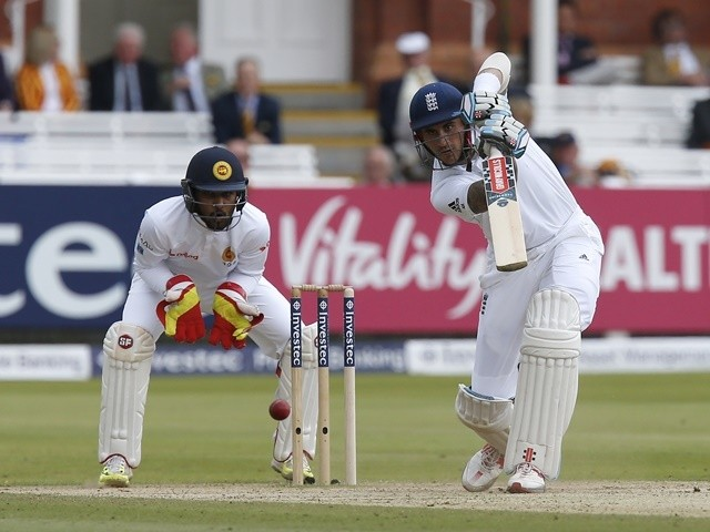 England's Alex Hales plays a shot watched by Sri Lanka's Dinesh Chandimal on the fourth day of the third Test on June 12, 2016