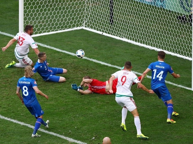 Birkir Saevarsson of Iceland scores an own goal against Hungary on June 18, 2016