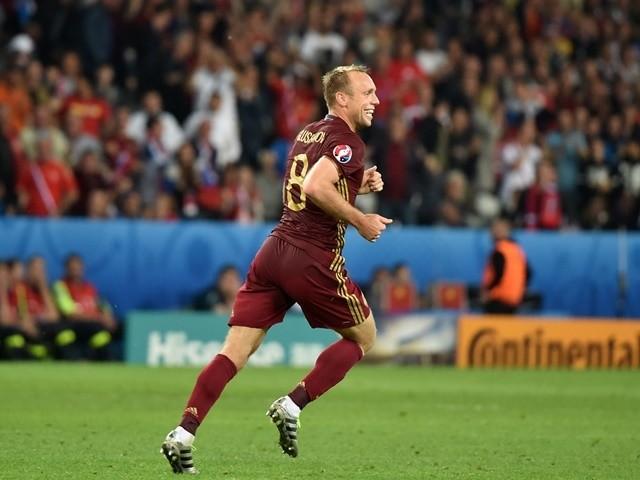 Denis Glushakov celebrates scoring during the Euro 2016 Group B game between Russia and Slovakia on June 15, 2016