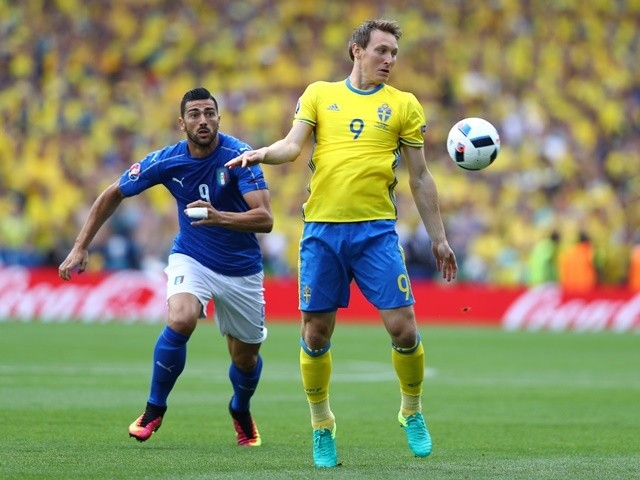 Graziano Pelle closes down Kim Kallstrom during the Euro 2016 Group E match between Italy and Sweden on July 17, 2016