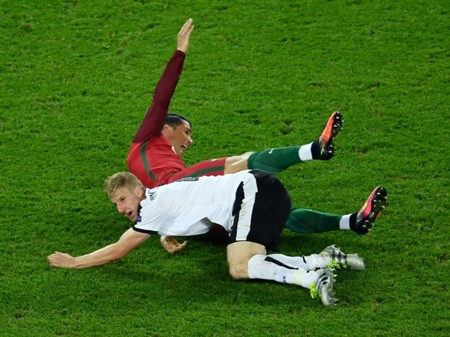 Martin Hinteregger fouls Cristiano Ronaldo during the Euro 2016 Group F match between Portugal and Austria on July 18, 2016