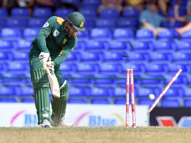 Quinton de Kock is clean bowled by Jerome Taylor during the sixth ODI match of the Tri-Series between West Indies and South Africa on June 15, 2016