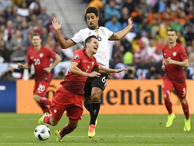 Sami Khedira fouls Arkadiusz Milik during the Euro 2016 Group C match between Germany and Poland on July 16, 2016