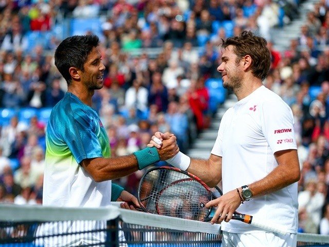 Fernando Verdasco shakes hands with Stanislas Wawrinka after his victory in their first-round match at Queen's on June 14, 2016