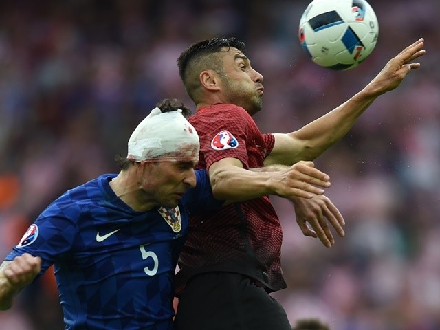 Vedran Corluka and Oguzhan Ozyakup during the Euro 2016 Group D game between Turkey and Croatia on June 12, 2016