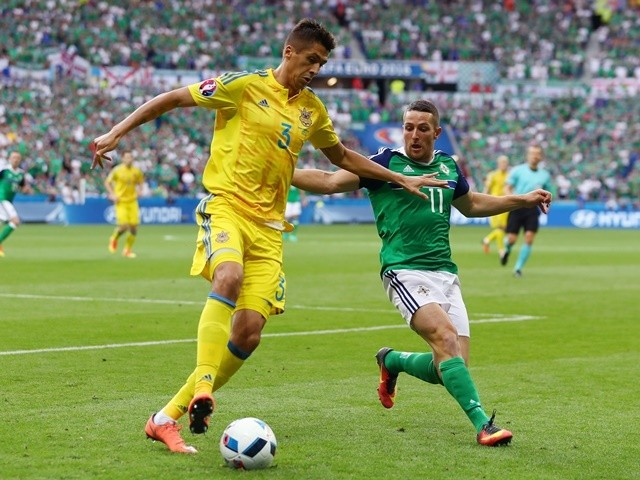 Yavhen Khacheridi and Conor Washington in action during the Euro 2016 Group C match between Ukraine and Northern Ireland on July 16, 2016