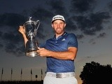Dustin Johnson of the United States poses with the winner's trophy after winning the US Open at Oakmont Country Club on June 19, 2016