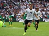 Mario Gomez celebrates scoring the opening goal during the Euro 2016 Group C match between Northern Ireland and Germany on June 21, 2016
