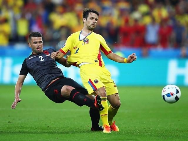 Alexandru Matel is tackled by Andi Lila during the Euro 2016 Group A match between Romania and Albania on June 19, 2016