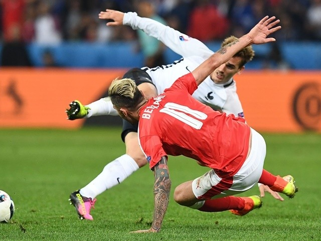 Antoine Griezmann is fouled by Valon Behrami during the Euro 2016 Group A match between Switzerland and France on June 19, 2016