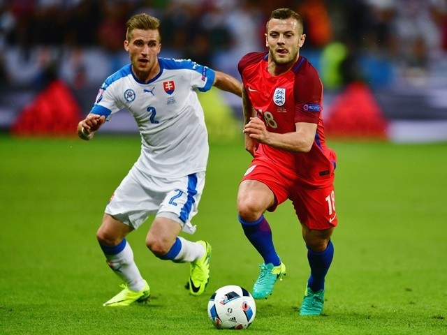Jack Wilshere and Peter Pekarik compete for the ball during the Euro 2016 Group B match between Slovakia and England on June 20, 2016